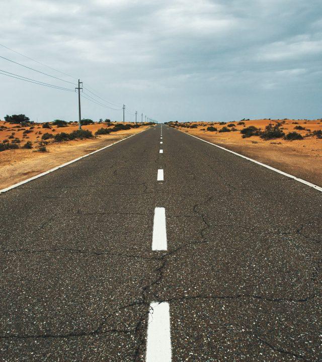 Road leading to horizon in desert.